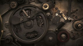 Camera moving through spinning gears stock footage
