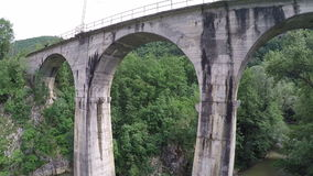 Camera moving under the railway bridge. Slow flight backwards, under the railway bridge stock video