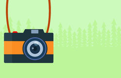 Camera and nature background Royalty Free Stock Photos