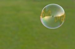 Camera nella bolla di sapone immagine stock