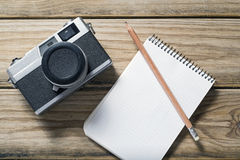 Camera and notebook Stock Images