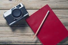 Camera and notebook Royalty Free Stock Photos