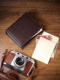 Camera and old pictures album, old memories Royalty Free Stock Image
