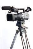 Camera op driepoot Stock Afbeelding