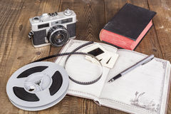 Camera and Open Notebook Stock Photos