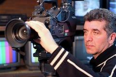 Camera Operator. Using a television camera Royalty Free Stock Images