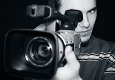 Camera operator. Cameraman recording with dv camera_monochrome photo Royalty Free Stock Image