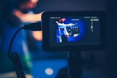 Free Camera Operator Taking Shots Of Men With Clapperboard Royalty Free Stock Photos - 188163158