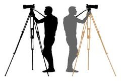 Camera operator on a tripod, photographer, cameraman silhouette. Stock Images