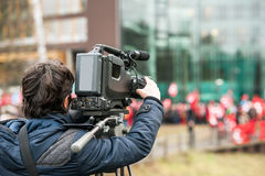 Camera operator working outside during breaking news live event Royalty Free Stock Image