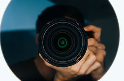 The camera and optics in the reflection. Look into the depths of Royalty Free Stock Photos