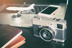 Camera and other travel objects on a computer Stock Photo