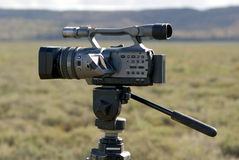 Camera Outdoor. A video camera on tripod, standing outdoors in an African plain Stock Image
