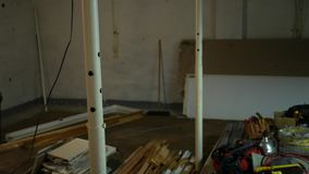 Camera pans across an unfinished basement in a state of remodel stock video