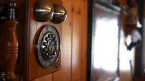 Camera pans to antique old landline telephone in country home. April 4 2018 stock video