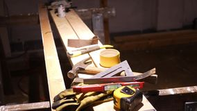Camera pans to professional contractor work bench in basement worksite stock video