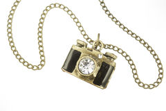 Camera pendant and necklace with gem stone, over white bacground Royalty Free Stock Photography