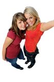 Camera phone simulation. Two young ladies having fun and simulating using a camera phone Royalty Free Stock Photos