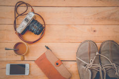 Camera Phones shoes on a wooden floor vintage. Stock Photos