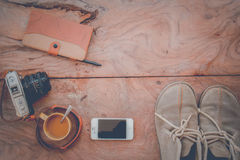 Camera Phones shoes on a wooden floor vintage. Stock Photography