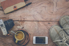 Camera Phones shoes on a wooden floor vintage. Royalty Free Stock Image