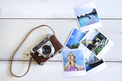 Camera and photo cards. On wooden background royalty free stock photos