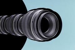 Camera photo lens. On azure background, concept paparazzi royalty free stock images