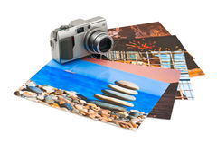 Camera and photo printouts (my photos) Royalty Free Stock Photography