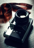 Camera and photographic film. Retro camera and photographic film Stock Images