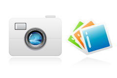 Camera with photographs Royalty Free Stock Images
