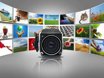 Camera with photographs Royalty Free Stock Photo