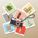 Camera with photographs of global landmarks. And tourist attractions from  Russia  Japan  USA  Britain  France  Italy and Greece mementos of a worldwide tour Stock Photography