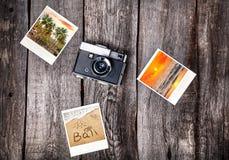 Camera and photos from Bali Royalty Free Stock Photo