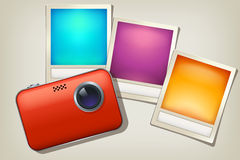 Camera and photos Stock Photography