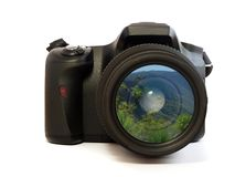 Camera Picture. SLR camera with a mountain scene in the lens Royalty Free Stock Photos