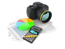 Camera with pie chart and report. On white background Stock Photos