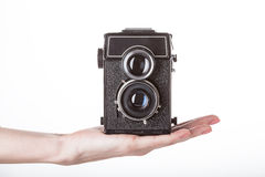 Camera presentation on hand Royalty Free Stock Photos