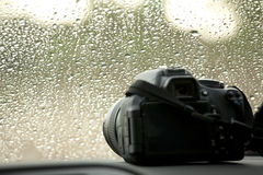 Camera and rain Royalty Free Stock Image