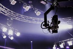 Camera record on crane on stage entertainment industry. Camera record on crane in production on studio and light to stage for entertainment industry Royalty Free Stock Photography