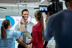 Camera Recording Video Of Businessman Corporate Interview And Makeup Artist stock photography