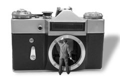 Camera repair. A repairman inside a photographic camera, camera repair concept Stock Photos