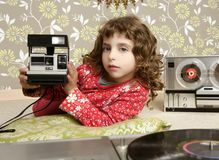 Camera retro photo little girl in vintage room Stock Image