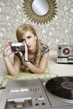 Camera retro photo woman in vintage room. Wallpaper Stock Photo