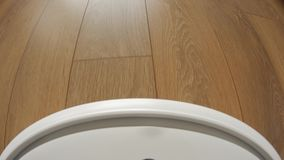 Camera on a robot vacuum cleaner to showing the cleaner`s movement in first-person perspective. Camera mounted on a robot vacuum cleaner to showing the cleaner` stock video footage