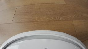 Camera on a robot vacuum cleaner to showing the cleaner`s movement in first-person perspective. The cleaner finds a trace of dust. Camera mounted on a robot stock video footage