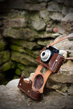 Camera on rocks Stock Images