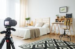 Camera in a room. Camera on a tripod in modern bedroom interior stock images
