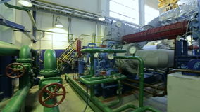 Camera Rotates and Shows Pipes and Compressing Equipment. KAZAN, TATARSTAN/RUSSIA - JUNE 12 2016: Camera rotates and shows green pipes compressing equipment and stock footage