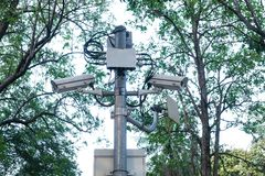 Camera security on post at park. Security camera system on post and nature background Royalty Free Stock Images