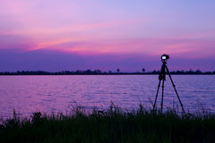 Camera shooting. On a tripod on the sunset background Royalty Free Stock Photography